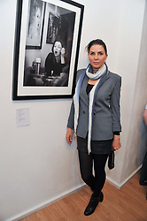 SADIE FROST at a private view of portrait photographs by Debbi Clark in support of the Sir Hubert von Herkomer Arts Foundation, held at The Strand Gallery, 32 John Adam Street, London WC2Non 8th May 2013.