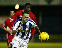 Photo: Chris Ratcliffe.<br />Colchester United v Bristol City. Coca Cola League 1. 17/01/2006.<br />Bas Savage of Bristol City chases down Karl Duguid of Colchester.
