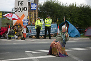 12 local activists locked themselves in specially made arm tubes to block the entrance to Quadrillas drill site in New Preston Road, July 03 2017, Lancashire, United Kingdom. 85 year old Nanne Powers supporting the activists. The 13 activists included 3 councillors; Julie Brickles, Miranda Cox and Gina Dowding and Nick Danby, Martin Porter, Jeanette Porter,  Michelle Martin, Louise Robinson,<br /> Alana McCullough, Nick Sheldrick, Cath Robinson, Barbara Cookson, Dan Huxley-Blyth. The blockade is a repsonse to the emmidiate drilling for shale gas, fracking, by the fracking company Quadrilla. Lancashire voted against permitting fracking but was over ruled by the conservative central Government. All the activists have been active in the struggle against fracking for years but this is their first direct action of peacefull protesting. Fracking is a highly contested way of extracting gas, it is risky to extract and damaging to the environment and is banned in parts of Europe . Lancashire has in the past experienced earth quakes blamed on fracking.