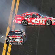 Sprint Cup Series driver Juan Pablo Montoya (42) and Sprint Cup Series driver Greg Biffle (16) spin into the wall during the Daytona 500 at Daytona International Speedway on February 20, 2011 in Daytona Beach, Florida. (AP Photo/Alex Menendez)