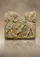Hittite relief sculpted orthostat stone panel of Herald's Wall. Limestone, Karkamıs, (Kargamıs), Carchemish (Karkemish), 900-700 B.C. Anatolian Civilisations Museum, Ankara, Turkey.<br /> <br /> On the left is a winged mixed creature with a human head and body who has a scorpion tail and bird legs; on the right is a human-like god. The figures fight with a winged bull standing on its hind legs. The scorpion-man is known as Girtablull. <br /> <br /> Against a brown art background. .<br />  <br /> If you prefer to buy from our ALAMY STOCK LIBRARY page at https://www.alamy.com/portfolio/paul-williams-funkystock/hittite-art-antiquities.html  - Type  Karkamıs in LOWER SEARCH WITHIN GALLERY box. Refine search by adding background colour, place, museum etc.<br /> <br /> Visit our HITTITE PHOTO COLLECTIONS for more photos to download or buy as wall art prints https://funkystock.photoshelter.com/gallery-collection/The-Hittites-Art-Artefacts-Antiquities-Historic-Sites-Pictures-Images-of/C0000NUBSMhSc3Oo