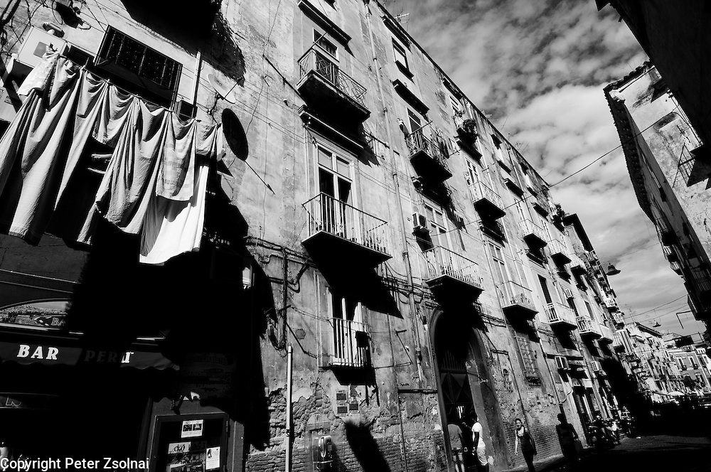 View of a street with clothes  hang on the balconies to dry in Naples, Italy