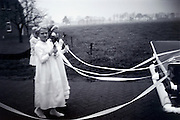Brides maids following the wedding car 1960s Holland