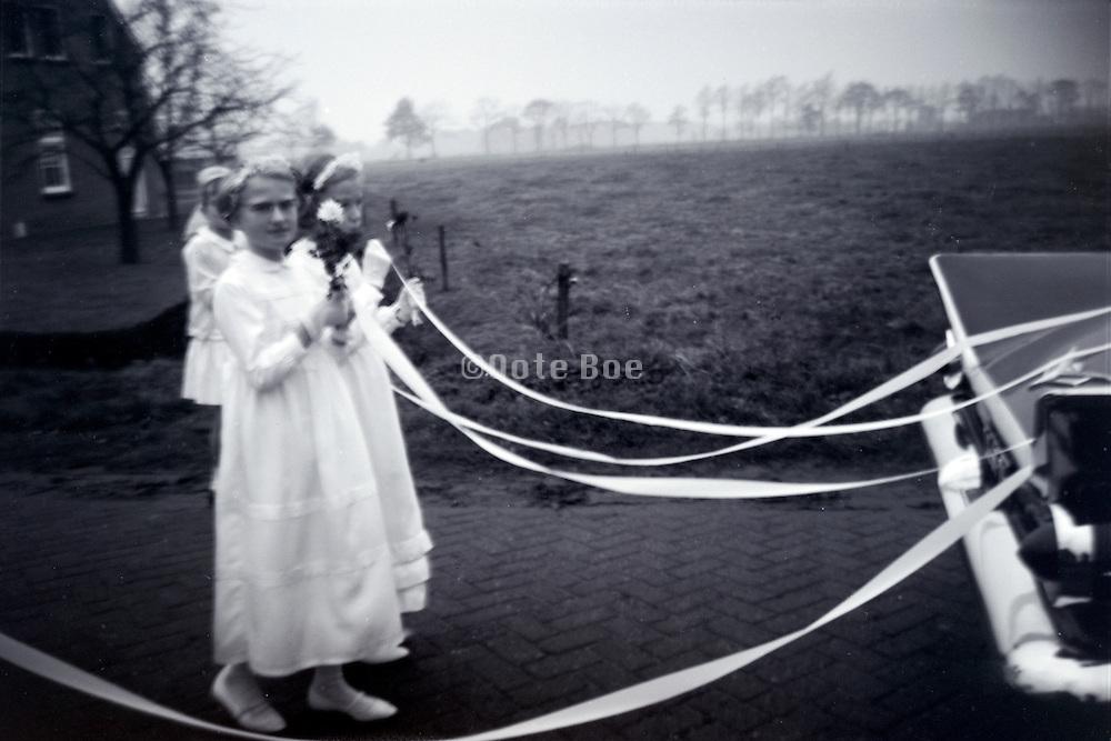 Brides maids following the wedding car 1960s Holland