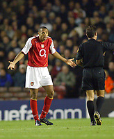 Fotball<br /> Champions League 2004/05<br /> Arsenal v Panathinaikos<br /> 2. november 2004<br /> Foto: Digitalsport<br /> NORWAY ONLY<br /> Arsenal's Thierry Henry protests his innocence as he is booked by referee Luis Cantalejo