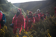 Hundreds of environmental activists stopping the open cast coal mine Ffos-y-Fran near Merthyr Tydfil, Wales from operating May 3rd 2016. The activists from Reclaim the Power wants the mine shut down and a moratorium on all future open coal mining in Wales. The group Reclaim the Power had set up camp near by and had over three days prepared the action and up to 300 activists all dressed in red went into the mine in the early morning. The activist were plit in three groups and carried various props signifying the red line in the sand, initially drawn in Paris at the COP21. The mine is one of the largest open cast coal mines in the UK and is run by Miller Argent who have to date extracted 5million tons of coal. The activists entered the mine unchallenged by any security or police and the protest went on peacefully till mid afternoon with no arrests made.  Open coal mining is hugely damaging to the local environment and  contributing to global climate change.