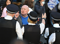 Football - 2020 / 2021 Premier League - Chelsea vs Brighton & Hove Albion - Stamford Bridge<br /> <br /> Chelsea fans protest outside the ground as a fan argues with the Police <br /> <br /> Credit : COLORSPORT/ANDREW COWIE