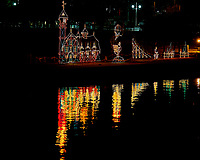 Holiday Light Display and Reflection on the Vinoy Basin in St. Petersburg, Florida. Image taken with a Nikon D300 camera and 200 mm f/2 lens (ISO 200, 200 mm, f/4, 1/15 sec).