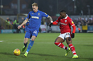 AFC Wimbledon midfielder Mitchell (Mitch) Pinnock (11) taking on Barnsley attacker Mamadou Thiam (26) during the EFL Sky Bet League 1 match between AFC Wimbledon and Barnsley at the Cherry Red Records Stadium, Kingston, England on 19 January 2019.