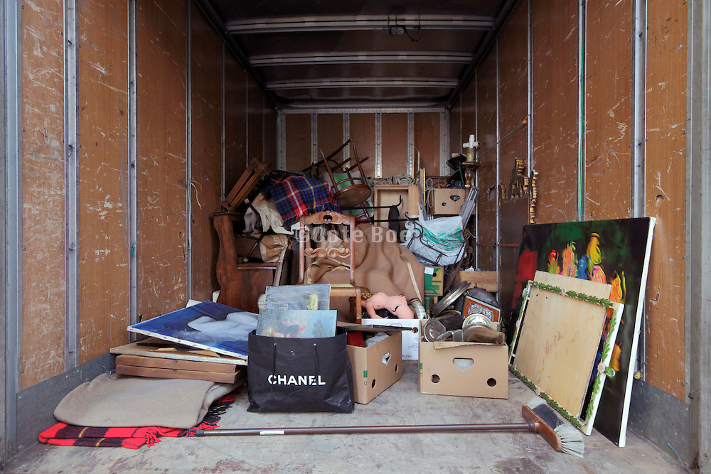 partly loaded truck with various household items