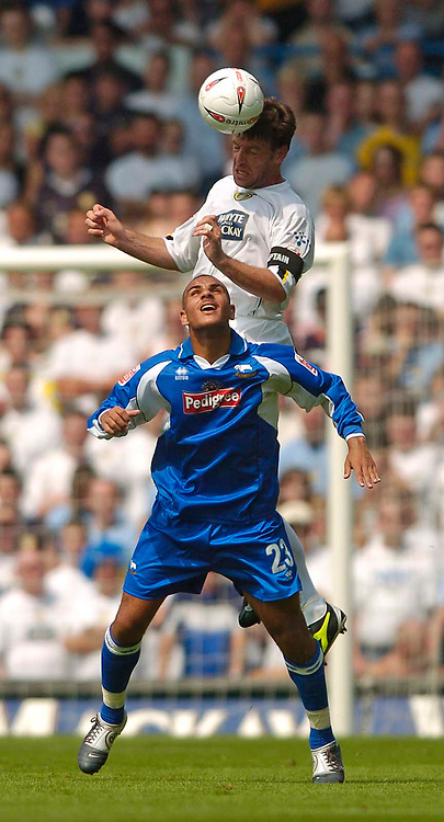 Fotball<br /> Leeds United v Derby County<br /> Coca Cola Championship<br /> 07/08/2004<br /> Foto: SBI/Digitalsport<br /> <br /> Leeds' skipper Paul Butler rises above Derby's Marcus Tudgay to win the ball.