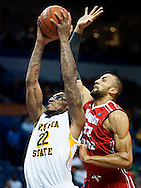 9 MARCH 2013 -- ST. LOUIS -- Wichita State University basketball player Carl Hall (22) is fouled by Illinois State University's Jackie Carmichael (32) while attempting to dunk the ball during the semifinals of the Missouri Valley Conference men's basketball tournament at the Scottrade Center in St. Louis Saturday, March 9, 2013. Wichita State won, 66-51. Photo © copyright 2013 Sid Hastings.