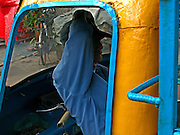 Vietnam, Ho Chi Min City: resting in the apecar.