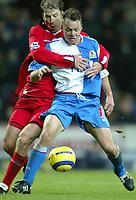 Fotball<br /> Premier League England 2004/2005<br /> 21.11.2004<br /> Foto: SBI/Digitalsport<br /> NORWAY ONLY<br /> <br /> Blackburn v Birmingham<br /> Barclays Premiership. 21/11/2004. <br /> <br /> Paul Dickov of Blackburn Rovers tussles with Kenny Cunningham of Birmingham City in the lead up to Blackburn Rovers' equalising goal.