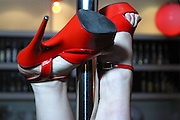 The shoes of a woman upside down during pole dancing class held at a central London pub.