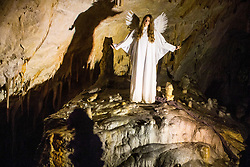 Actor dressed as an angel performs during the Living Nativity Scenes inside Postojna Cave, on December 21, 2017 in Postojna, Slovenia. Living Nativity Scene is staged along a 5 km long path through the world-famous Postojna Cave in Slovenia with some 200 people performing and working. Photo by Vid Ponikvar / Sportida