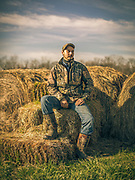 Derek Lawson, Livestock manager with Foxhollow Farms, poses for a portrait out on the farmland. Lawson has been with Foxhollow for six years and looks over the over 300 cattle and hair sheep.