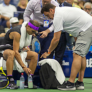 2019 US Open Tennis Tournament- Day Ten.  Rafael Nadal of Spain receives treatment on his arms during his match against Diego Schwartzman of Argentina in the Men's Singles Quarter-Finals match on Arthur Ashe Stadium during the 2019 US Open Tennis Tournament at the USTA Billie Jean King National Tennis Center on September 4th, 2019 in Flushing, Queens, New York City.  (Photo by Tim Clayton/Corbis via Getty Images)