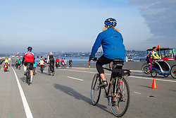 Seattle, Washington. April 3, 2016. Bicyclists on the new Evergreen Point (State Route 520) floating bridge on the opening day of the new bridge. The new bridge is the longest, and widest, floating bridge in the world.