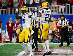 LSU Tigers wide receiver Terrace Marshall Jr. (6) reacts after LSU Tigers wide receiver Justin Jefferson (2) scored a touchdown during the first half against Oklahoma Sooners in the 2019 College Football Playoff Semifinal at the Chick-fil-A Peach Bowl on Saturday, Dec. 28, in Atlanta. (Vasha Hunt via Abell Images for the Chick-fil-A Peach Bowl)
