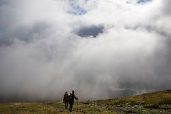 © Licensed to London News Pictures.  11/09/2021. Stirling, Scotland. Hikers on Ben Ledi near Callander, Stirling on a windy Saturday afternoon. Photo credit: Marcin Nowak/LNP