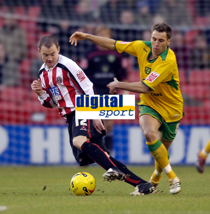 Photo: Jed Wee.<br />Sheffield United v Norwich City. Coca Cola Championship.<br />26/12/2005.<br />Sheffield United's Alan Quinn (L) tries to turn away from Norwich's Darren Huckerby.