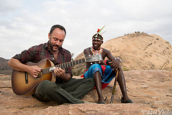 "Dave Matthews (@davematthewsband) plays his song ""Mother of Africa"" with his friend, Robert Lemaian, at Reteti Elephant Sanctuary (@r.e.s.c.u.e) in northern Kenya. I met Dave in the middle of a blizzard at Standing Rock in North Dakota last year and by some small miracle, he agreed to come to the elephant sanctuary and allow me make a short film. It will launch next week and screen at his 47 concerts. Dave has tirelessly worked as an advocate for conservation efforts and contributed large sums to peacefully proactive environmentalist groups. Go see him if you can. Not only is his music beautiful but he is an authentically awesome human being. <br /> <br /> Reteti Elephant Sanctuary, in northern Kenya is the first ever community-owned and run elephant sanctuary in Africa. The sanctuary provides a safe place for injured elephants to heal and later, be returned back to the wild.  You can support this incredible place and the people who protect wildlife. Buy a raffle ticket for only $10 to support Reteti.You could win a trip to Kenya, see Dave Matthews in concert and take home Dave's handmade guitar with @prizeo (Link in profile). Not only will you be helping care for orphaned baby elephants and strengthening community ties, you'll also have a chance to win a life-changing trip to see the sanctuary in person. The first $10,000 in funds raised will be generously matched by Elephant Gems (@elephantgems).<br /> <br /> Reteti operates in partnership with Conservation International (@conservationorg) who provide critical operational support and work to scale the Reteti community-centered model to create lasting impacts worldwide. <br /> <br /> Photo by @amivitale."
