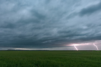 This thunderstorm rolled through the wheat fields of western Nebraska shortly before sunset. It was formerly tornado warned, but had weakened by the time I approached it. There was quite a bit of lightning as the storm got closer.