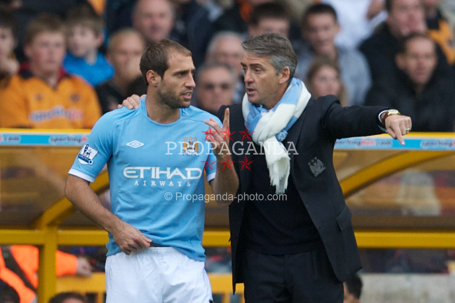 WOLVERHAMPTON, ENGLAND - Saturday, October 30, 2010: Manchester City's manager Roberto Mancini prepares to bring on substitute Pablo Zabaleta during the Premiership match against Wolverhampton Wanderers Molineux. (Pic by: David Rawcliffe/Propaganda)
