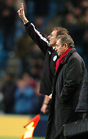 Photo: Richard Lane.<br /> Manchester City v Liverpool. Barclaycard Premiership.<br /> 28/12/2003.<br /> Gerald Houlier looks on as Phil Thompson gives out the orders.