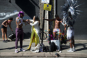 Hackney Carnival on 8th September 2019 in London, United Kingdom. Revellers getting dressed.