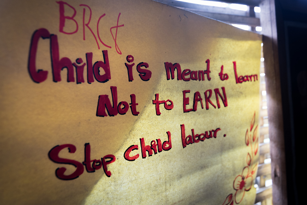 """14 September 2018, Damak, Nepal: """"Child is meant to learn, not to Earn. Stop child labour"""" reads a message on the wall, from the Bhutanese Refugee Children Forum in the Beldangi refugee camp in the Jhapa district of Nepal, which hosts more than 5,000 Bhutanese refugees."""