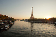 The iconic Eiffel Tower stands by the banks of the River Seine in Paris, France