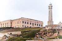 """United States, California, San Francisco. The famous Alcatraz prison island, also known as """"The Rock"""". The lighthouse on top of the hill."""