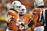 AUSTIN, TX - OCTOBER 18:  Dalton Santos #55 of the Texas Longhorns celebrates after a tackle against the Iowa State Cyclones on October 18, 2014 at Darrell K Royal-Texas Memorial Stadium in Austin, Texas.  (Photo by Cooper Neill/Getty Images) *** Local Caption *** Dalton Santos