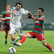 Karsiyakaspor's Fuat ERARSLAN (R) and Altayspor's Sehmus OZER (L) during their Play Off First leg match at Ataturk olympic Stadium in Istanbul Turkey on Monday, 17 May 2010. Photo by TURKPIX