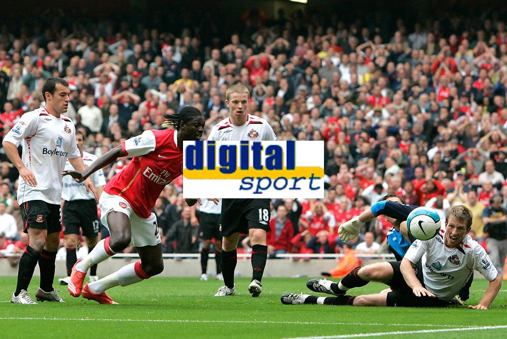 Photo: Tom Dulat.<br /> Arsenal v Sunderland. The FA Barclays Premiership. 07/10/2007.<br /> Danny Collins of Sunderland keeps eyes on the ball while Emmanuel Adebayor of Arsenal misses shot on targer