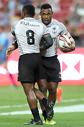 April 29, 2018 - Singapore - Waisea Nacuqu (left) of Fiji is embraced by Eroni Say after scoring a try during the Cup Final match between Fiji and Australia at the Rugby Sevens tournament at the National Stadium. Singapore. (Credit Image: © Paul Miller via ZUMA Wire)