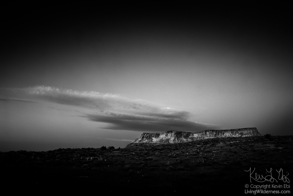 Clouds pass over a mountain called LeChee Rock in the Navajo Nation near Page, Arizona. From a particular angle, the mountain resembles a man on his back sleeping, prompting some to call the mountain The Sleeping Indian. This was originally a color image that has been converted to black and white.