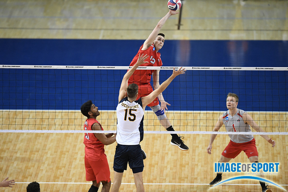 Ohio State Buckeyes middle blocker Nick Laffin (12) spikes the ball as UC Irvine Anteaters middle blocker Matthew Younggren (15) defends during the opening round game of the NCAA college volleyball championship in Los Angeles, Tuesday, May 1, 2018. Ohio State defeated UC Irvine 25-19, 22-25, 25-23, 22-25, 16-14.