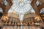 People stroll through Galleria Vittorio Emmanuele II, the centre of luxury shopping in central Milan, on 7th December 2008 in Milan, Italy. The Galleria is known affectionately as the living room of Milan because of its popularity as a meeting place, and hosts the original Prada store.