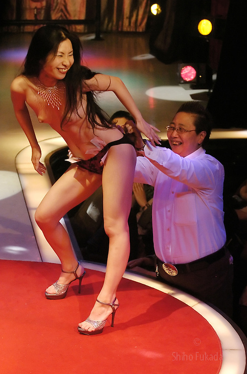 Strippers perform at a lesbian show in Tokyo, Japan.