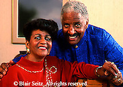 Active Aging Senior Citizens, Retired, Activities, Portrait, African American Elderly Couple at Home
