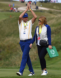 Team Europe's Ian Poulter with wife Katie Poulter make their way to the 18th green ahead of the closing ceremony during day three of the 43rd Ryder Cup at Whistling Straits, Wisconsin. Picture date: Sunday September 26, 2021.