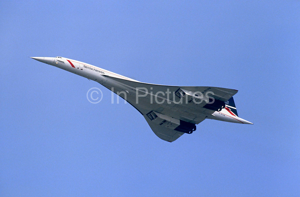 A Concorde supersonic airliner registration G-BOAB flies overhead during its service for British Airways - en-route for a foreign destination. The delta-winged jet was first flown in 1969, entering commercial service in 1976 for 27 years until the disastrous in Paris ended its viability. Aérospatiale-BAC Concorde was a turbojet-powered supersonic passenger airliner or supersonic transport (SST). With a program cost of £1.3 billion and a unit cost of £23 million in 1977.
