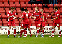 Photo: Leigh Quinnell.<br /> Swindon Town v Grimsby Town. Coca Cola League 2. 14/10/2006. Swindons Andy Monkhouse(far left) has a celebration dance with his team mates after his goal.