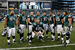 Philadelphia Eagles long snapper Jon Dorenbos #46 poses for a picture in front of the Defensive Line after the NFL game between the Washington Redskins and the Philadelphia Eagles. The Eagles won 34-10 at Lincoln Financial Field in Philadelphia, Pennsylvania on Sunday, January 1st 2012. (AP Photo/Brian Garfinkel)