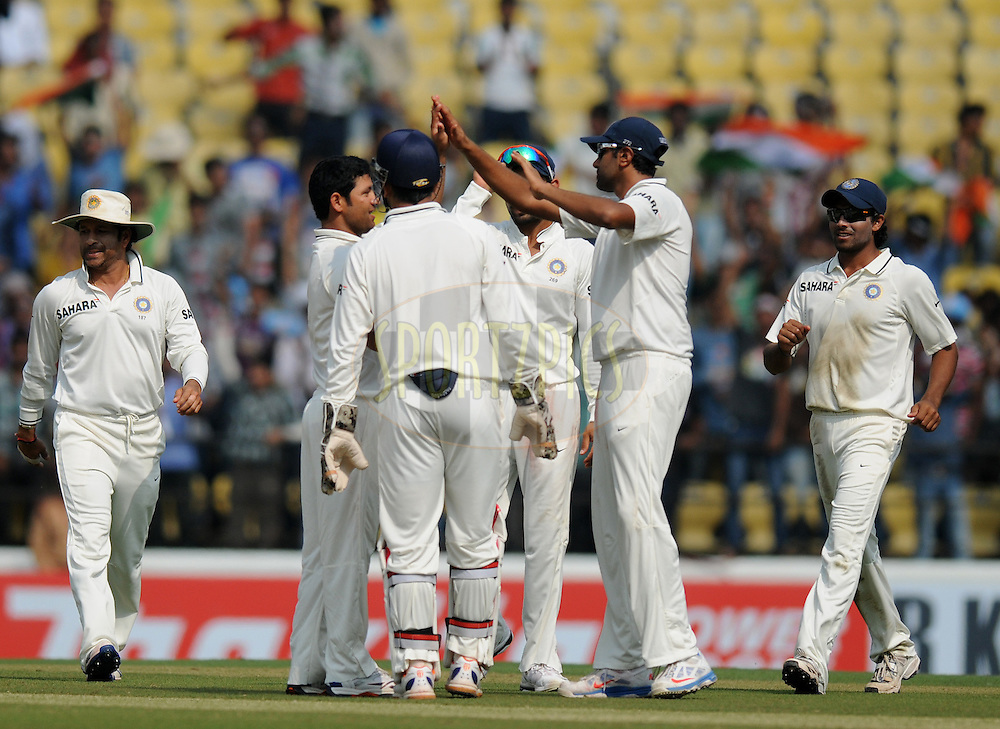 Piyush Chawla of India celebrate the wicket of Joe Root of England with teammates during day two of the 4th Airtel Test Match between India and England held at VCA ground in Nagpur on the 14th December 2012..Photo by  Pal Pillai/BCCI/SPORTZPICS .