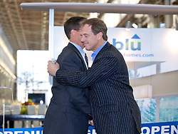 Tom Sheaff, of Lennar Mare Island is embraced by Bill Haney, Co-founder and President of Blu Homes  as Blu Homes opens their West Coast factory on Mare Island in Vallejo, California Dec. 1, 2011.  Over 400 guests attended a ribbon cutting ceremony at the 250,000-square-foot facility.