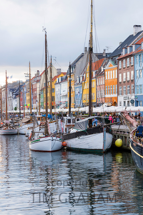 Sailing boats at famous Nyhavn, 17th Century waterfront canal and entertainment district in Copenhagen, Denmark